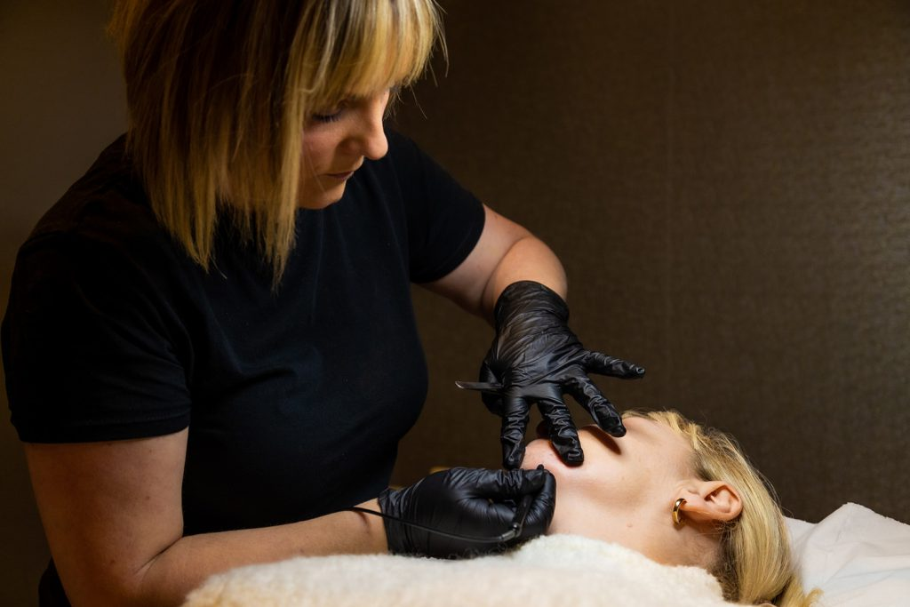 Woman performing electrolysis treatment